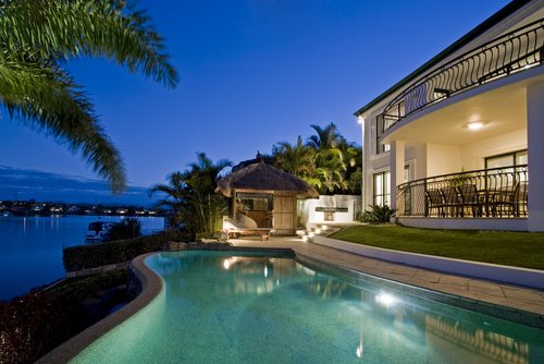 gold coast canal house with interior and pool lighting
